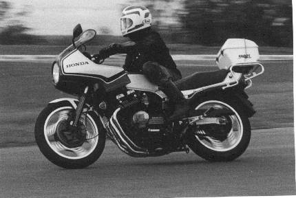 Phil Hall on his CBX doing travelling marshall duties, Oran Park 1984